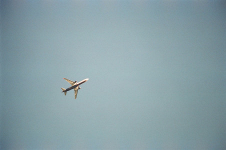 An airplane flying above To Tau Bay Village